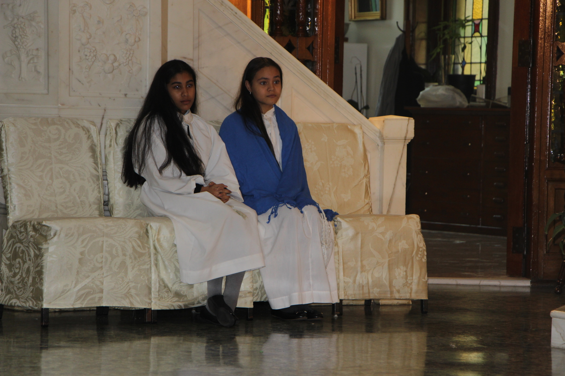 Blessed Sacrament Catholic Academy students seated on altar