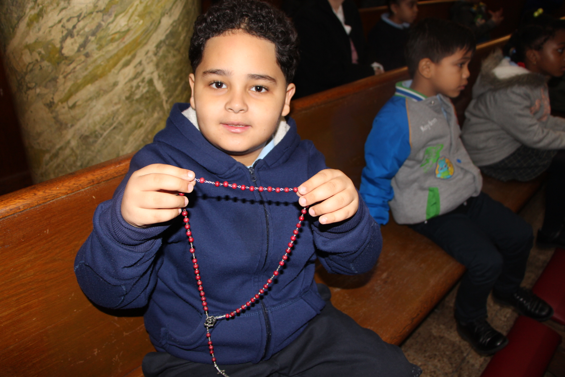 Blessed Sacrament Catholic Academy student displaying a rosary