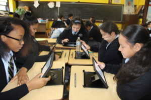 students working with ipads in class