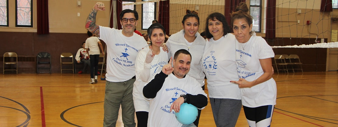 faculty members at volleyball game